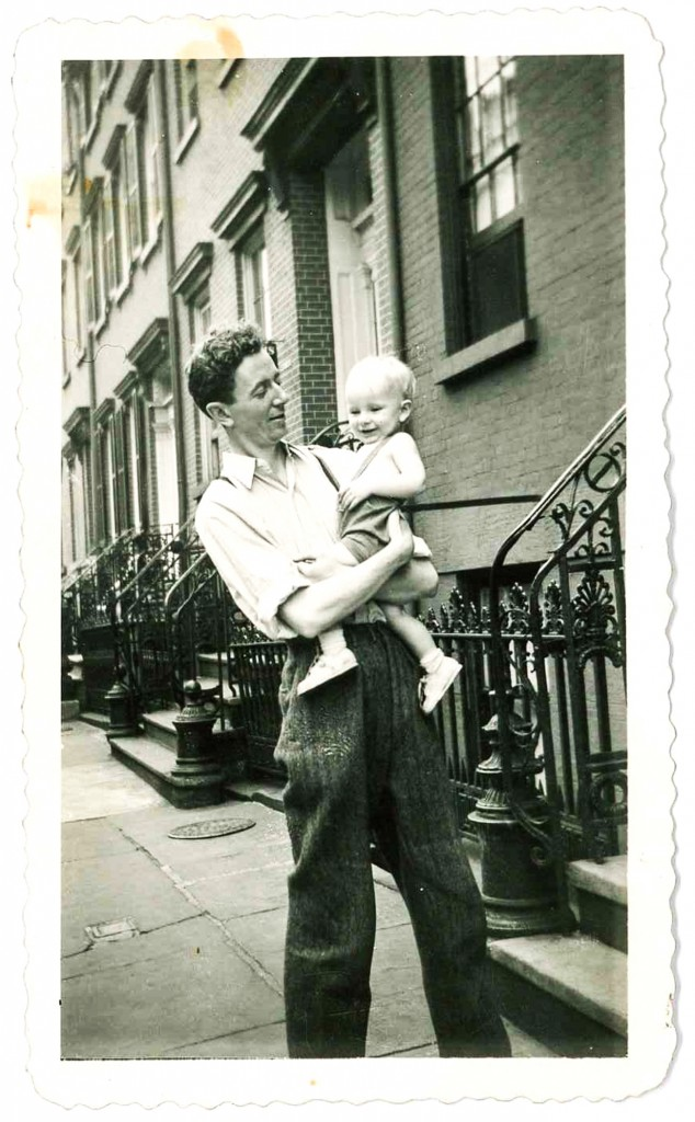Patrick in the arms of his father, Joseph, outside 29 Bethune Street